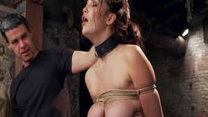 Hot brunette Holly Michaels really enjoys tied up